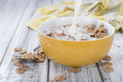 Pouring Milk on a portion of Cornflakes Stock Photography