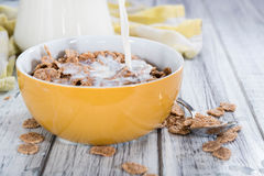 Pouring Milk on a portion of Cornflakes Royalty Free Stock Images