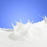 Pouring milk splash. Pouring white milk splash on colour background Stock Photo