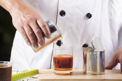 Pouring milk in to Tea Stock Photo