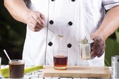 Pouring Milk to Tea Stock Photography