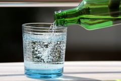Pouring mineral water in the glass Stock Images