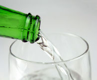 Pouring mineral water in the glass Royalty Free Stock Images