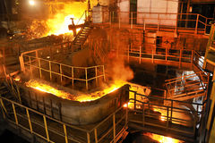 Pouring molten steel. Inside on steel factory Stock Images