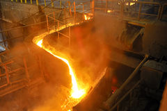 Pouring molten steel. Inside the plant Stock Photography