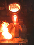 Pouring of Molten Steel (Cast Iron). Pouring of Molten Cast Iron steel in a die at a foundry in India. Iron and steel industry stock photos