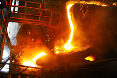 Pouring molten steel in transportation device. Inside of factory Stock Images