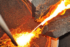 Pouring molten steel in transportation device. Detail Stock Photography