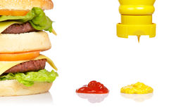 Pouring mustard Royalty Free Stock Images