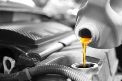 Pouring oil into car engine. Closeup stock image