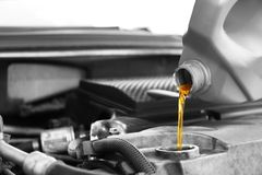 Pouring oil into car engine royalty free stock photography