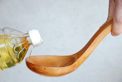 Pouring Oil In Wooden Spoon Royalty Free Stock Image