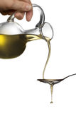 Pouring oil from jar on spoon Royalty Free Stock Photo