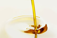 Pouring oil Stock Photos