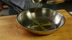 Pouring Oil in Stainless Pan stock video footage
