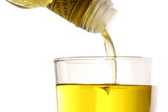 Pouring olive oil Royalty Free Stock Image