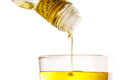 Pouring olive oil from bottle Stock Photos