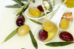 Pouring olive oil Royalty Free Stock Photography