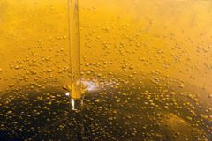 Pouring olive oil liquid. Close up view of pouring olive oil golden liquid Stock Photo