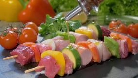 Pouring olive oil over raw meat skewers stock video footage
