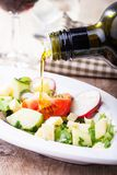 Pouring olive oil Stock Images