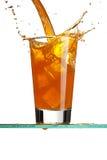 Pouring a orange beverage Stock Photos