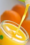 Pouring Orange Juice Royalty Free Stock Photos