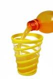Pouring the orange juice royalty free stock image