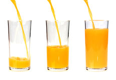 Pouring orange juice into the glass Royalty Free Stock Photo