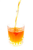 Pouring orange juice into the glass isolated Royalty Free Stock Photography