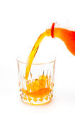 Pouring orange juice into the glass isolated Royalty Free Stock Photos