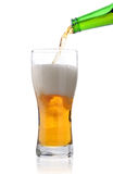 Pouring out light beer. Isolate on a white royalty free stock image