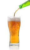 Pouring out light beer. Isolate on a white stock photography