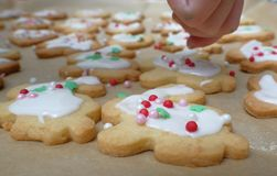 Glazing cookies. Pouring over glazing mass over dough pieces Stock Photo