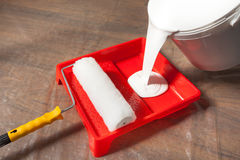 Pouring Paint In A Paint Tray Royalty Free Stock Photography