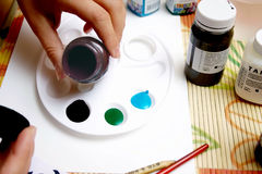 Pouring of paints Stock Images