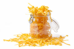 Pouring Pasta In A Jar Stock Image