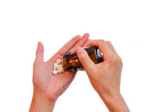 pouring pill to hand  (medicine in hand) Stock Photography