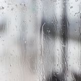 Pouring rain on very wet glass pane. Pouring rain on very wet square glass pane Stock Images