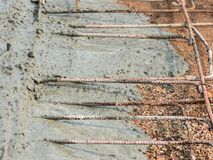 Pouring ready-mixed concrete after placing steel reinforcement to make the road Stock Images