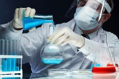 Pouring reagents Stock Images