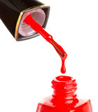 Pouring red nail polish Stock Photo