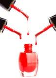 Pouring red nail polish Stock Photo