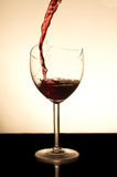 Pouring red vine Stock Photo