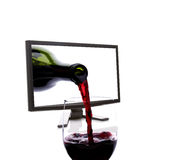 Pouring Red Wine. Into a glass through a LCD computer monitor isolated on a white background Royalty Free Stock Photography
