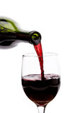 Pouring Red Wine. Into a glass Royalty Free Stock Images