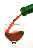 Pouring Red Wine. Against white background Royalty Free Stock Images