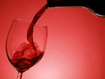 Pouring red wine Stock Images