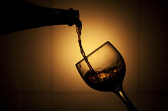 Pouring red wine Stock Image