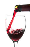 Pouring red wine Royalty Free Stock Photo